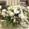 Букет из орхидеи с ранункулюсами и сиренью фото