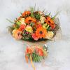 Букет из альстромерий, гербер и роз в упаковке фото