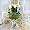 Букет из 11 белых роз 60 см. в упаковке фото