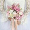 Букет невесты из роз, орхидей и фрезии фото