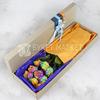 Букет из 9 радужных роз в коробке фото
