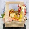 Композиция из гвоздик, роз и орхидей в подарочной коробке фото