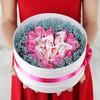 Композиция из роз и гипсофил с конфетами Раффаэлло фото