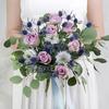 Букет невесты из роз, нигеллы и эрингиума фото