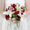Букет невесты из гвоздик, лилий и роз фото