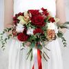 Букет невесты из роз, орхидей, хлопка и эвкалипта фото