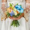Букет невесты из роз, орхидей и гвоздик фото