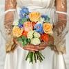 Букет невесты из роз, гвоздик и эвкалипта фото